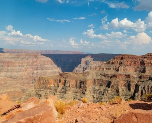 Grand Canyon mountain view with blue sky and white cloud   Feature   8 Things To Do At The Grand Canyon   Arizona Guide