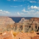 Grand Canyon mountain view with blue sky and white cloud | Feature | 8 Things To Do At The Grand Canyon | Arizona Guide