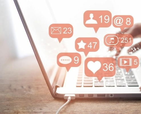 a laptop with pink social media icons   Feature   Social Media Planning -- A Winning Strategy Guide For Home Accounts