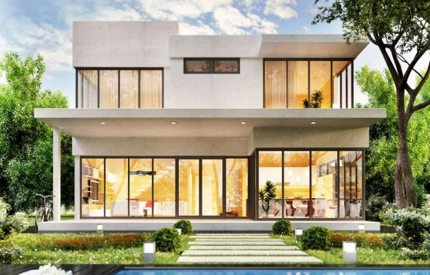a luxury and modern house is turning all the light up has garden and pool on the front yard   Why a Photo Caption Matters   How to Write And Edit Captions for Your Rental Portfolio