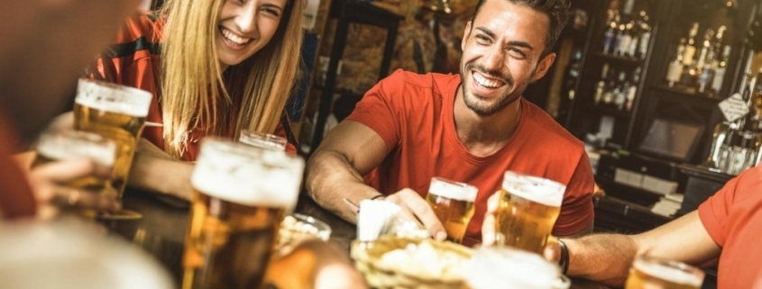 group of friends drinking and chilling together | feature | The Top 10 Arizona Breweries To Visit