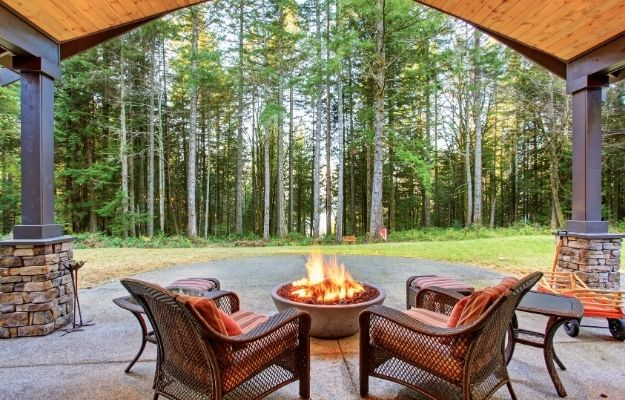 2 chairs are placed with the hear with the forest view   Don't Forget Outside   The Best Type Of Photos To Use In Your Rental Property Listing