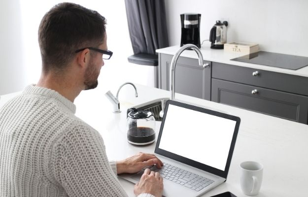 a man wearing glasses and using laptop | Have A Responsive Website | Tips For Property Management Marketing