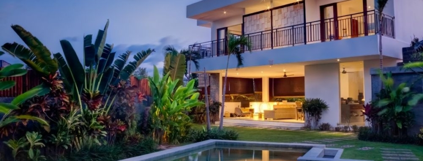 a villa with a pool on the front and surrounded by trees | Feature | 3 Ways Your Vacation Rental Could Benefit from Channel Management