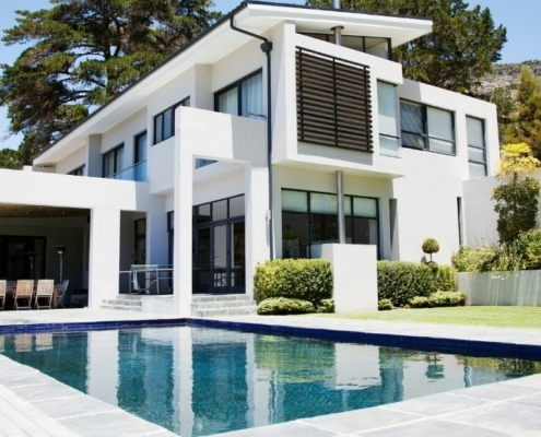 a villa with a pool on the front | Feature |