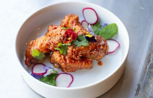 chicken wing with sauces decorated on a white bowl   What Is Local SEO?  